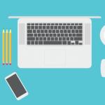 dessin clavier ordinateur portable avec bloc et stylos et tasse à café