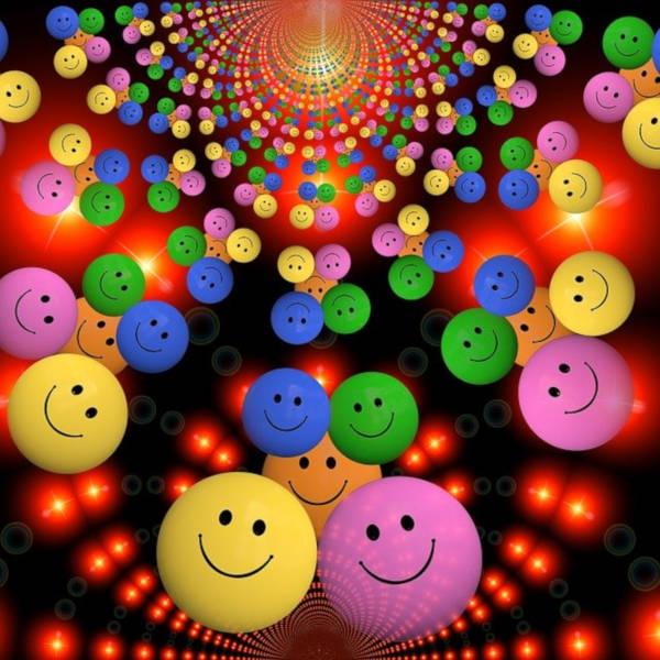 smileys sourires en couleurs sur fond rouge